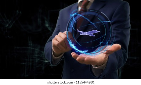 Businessman shows concept hologram 3d jet on his hand. Man in business suit with future technology screen and modern cosmic background