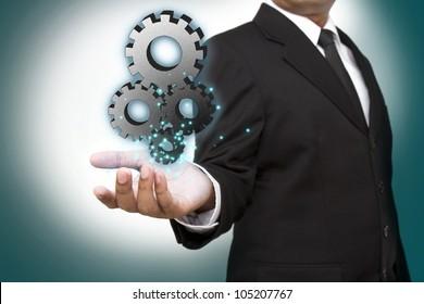 Businessman shows gear to success