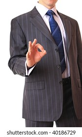 A businessman shows the gesture of consent.