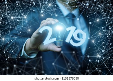 Businessman shows the inscription in 2019. The concept of a new business year.