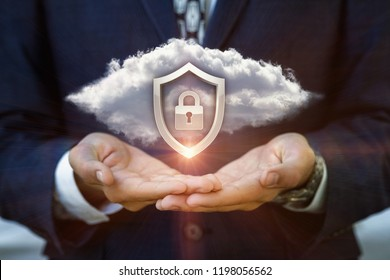 Businessman shows a Security system of the cloud data .