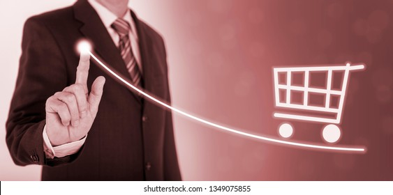 businessman shows success with chart and shopping cart