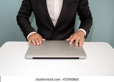 Businessman shut down laptop