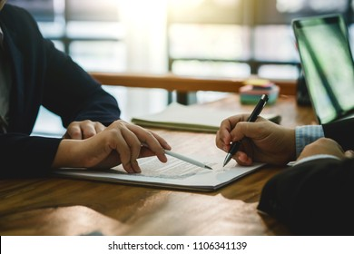 Businessman signed a contract agreement to invest together.