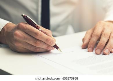 businessman signing business partnership contract