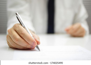 businessman is signing contract
