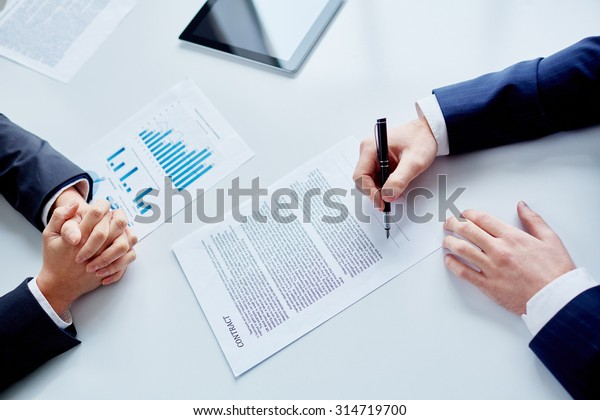 Businessman signing contract after making agreement