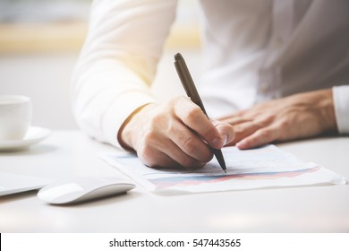 Businessman signing contract. Close up. Deal concept