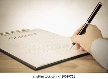 Businessman signing contract. Concept of Joint stock company agreement.