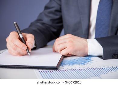 Businessman signing a document - closeup shot