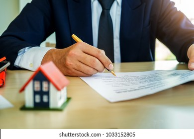 businessman signing document concept, focus on male hand holding pen, putting signature on legal document, Agreement, contract and insurance concept for Trading estate.