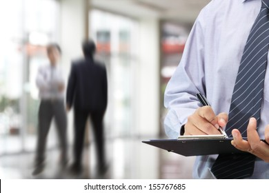 Businessman signing a document in the office