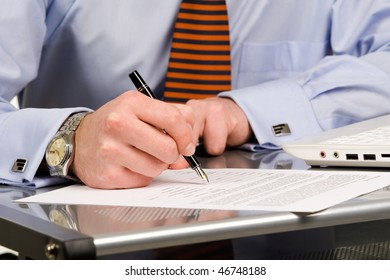 Businessman signing document with pen, isolated