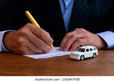 Businessman is signing insurance agreement