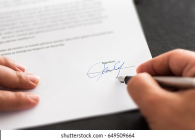 Businessman Signing An Official Document Or Contract