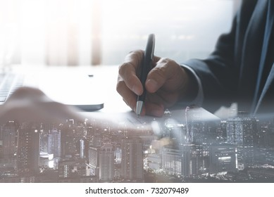 Businessman signing on real estate contract or insurance business with apartment in the city and financial double exposure and copy space, real estate investment business concept