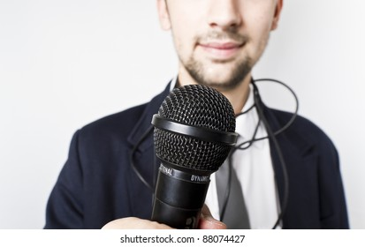 Businessman or Singer in suit. Microphone in his hand ready to perform.