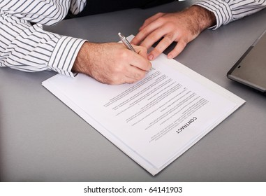 Businessman singing contract