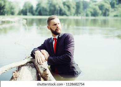 Businessman sinking in water