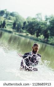 Businessman sinking in water. Splashing water