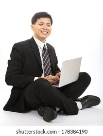 Businessman sit and search information with laptop in studio