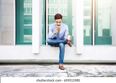Businessman siting outdoor and working on smart phone, Lifestyle of modern male to communicate, message or use technology in business, Always connected concept