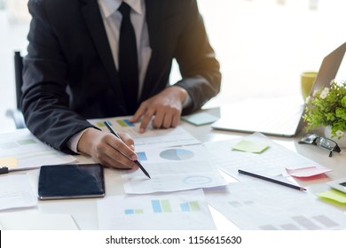 Businessman sitting analyze document information in the workplace.