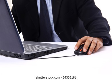 businessman sitting by desk at office working on the laptop