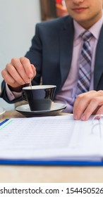 Businessman sitting in a cafe drinking coffee.