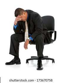 Businessman: Sitting In Chair Feeling Depressed or Tired