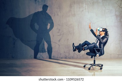 Businessman sitting in chair  wearing virtual reality glasses. Concept of powerful man