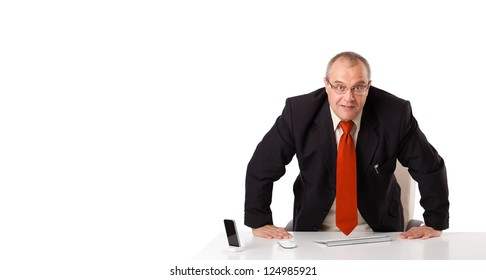 businessman sitting at desk with copy space, isolated on white