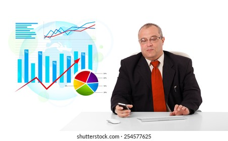 Businessman sitting at desk with statistics, isolated on white