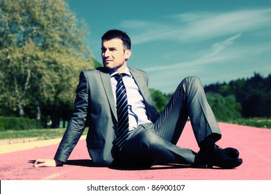 businessman sitting down with special photographic processing