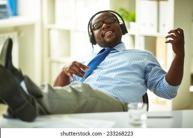 Businessman sitting in headphones in office