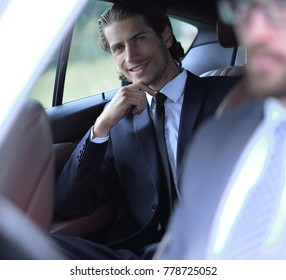 businessman sitting in his car.