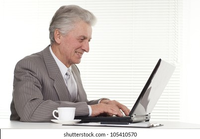 Businessman sitting at the laptop on a isolate