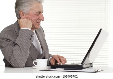 Businessman sitting at the laptop on a white