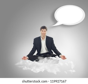 Businessman sitting in lotus position on a cloud