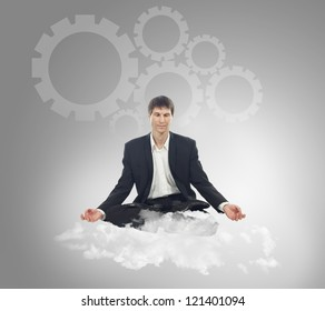 Businessman sitting in lotus position on a cloud and think mechanical thoughts