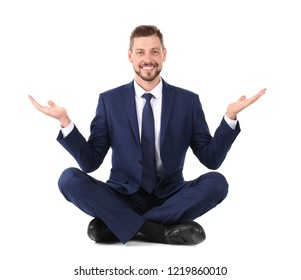 Businessman sitting in lotus position and showing balance gesture on white background