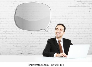 businessman sitting with notebook and bubble talk