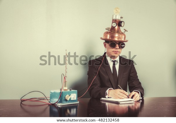 Businessman sitting at office desk with notepad
