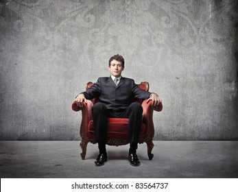 Businessman sitting on an armchair