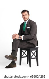 businessman sitting on a chair against white background