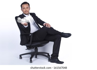 Businessman sitting on a chair and presents cloud technology