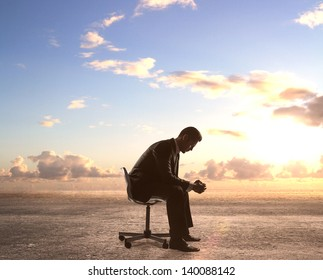businessman sitting on chair and sky