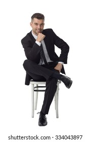 Businessman sitting on chair and thinking Full Length Portrait isolated on White Background