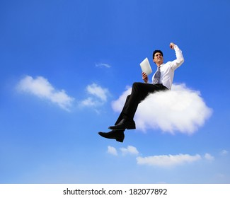 businessman sitting on a cloud working with tablet pc computer , cloud computing concept