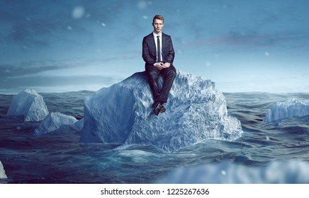 Businessman sitting on an Iceberg